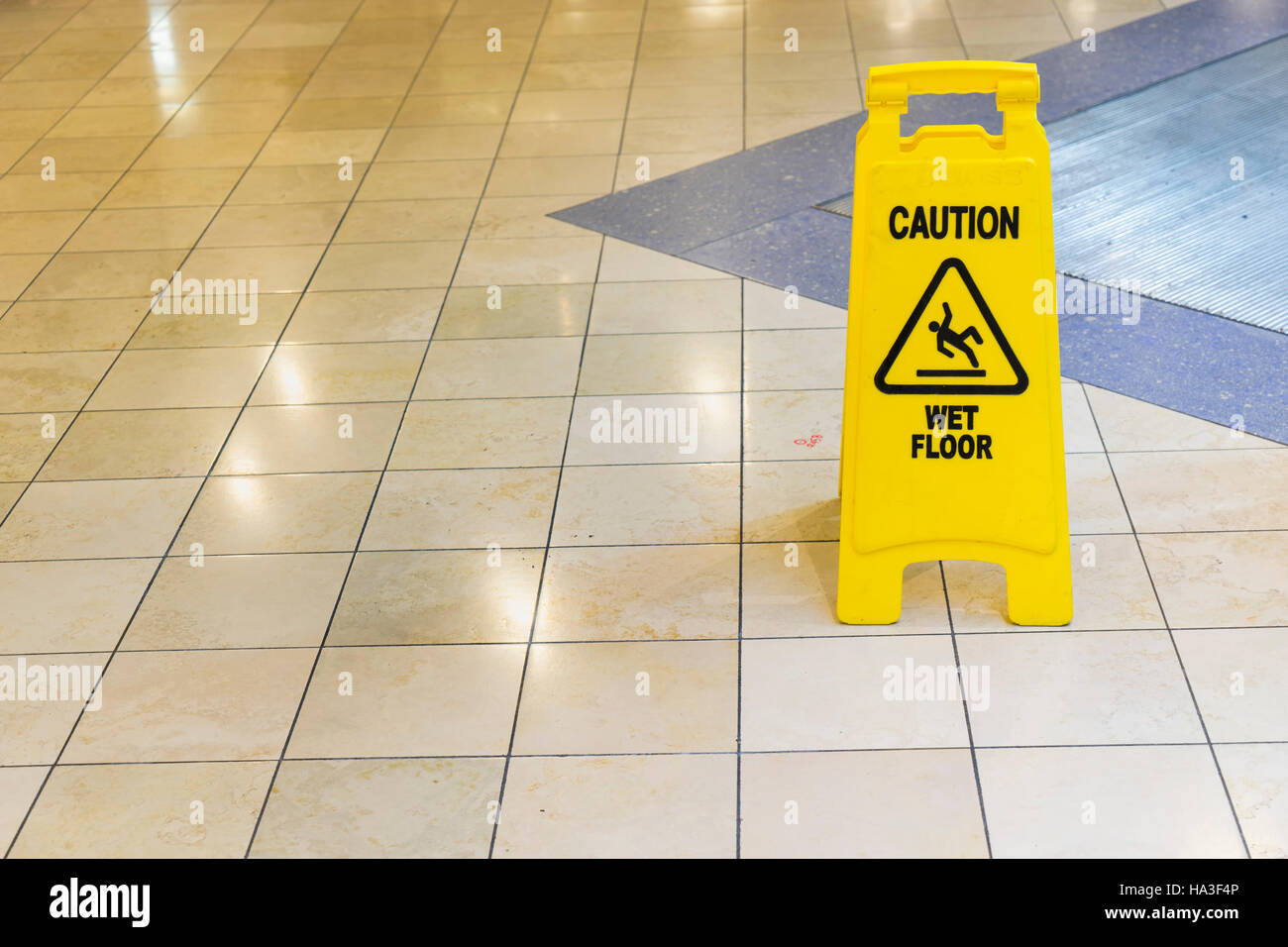 yellow wet sign on the floor - can use to display or montage on product - Stock Image