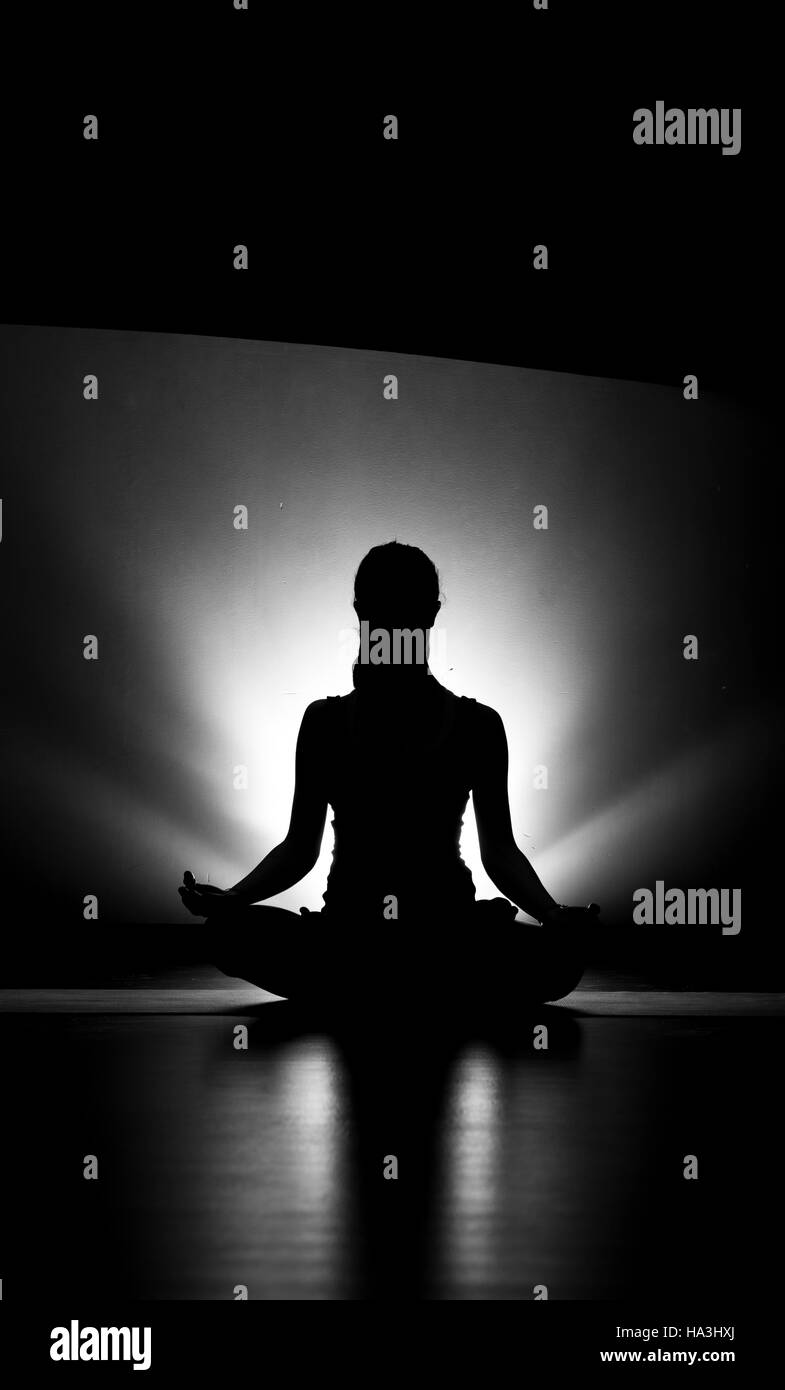 Woman Doing Yoga Lotus Pose Silhouette Black And White In Studio Stock Photo Alamy