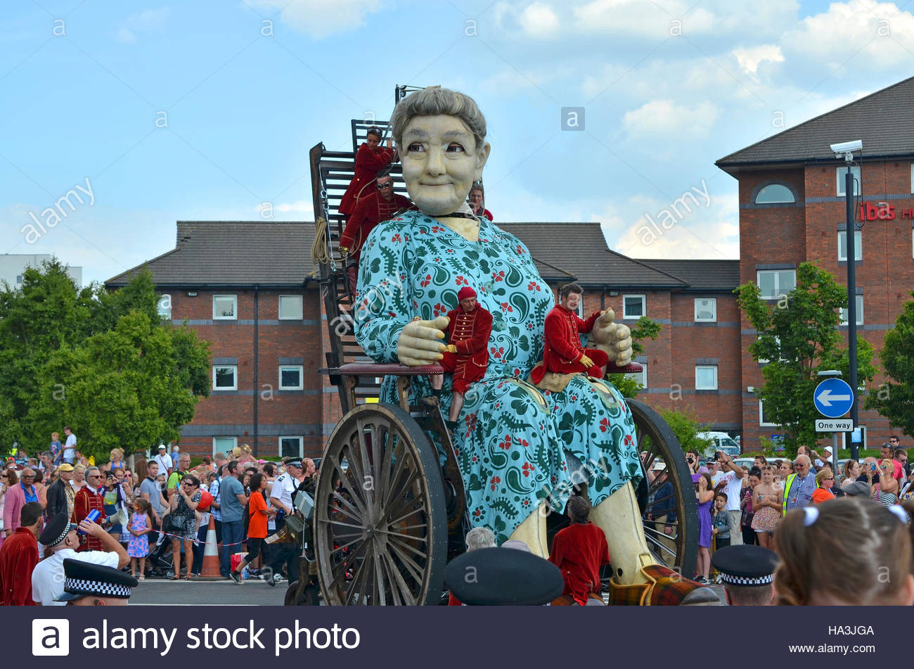 ' Grandma Giant ' one of the French puppeteers ' Royal De Luxe ' giant marionettes, is wheeled around - Stock Image