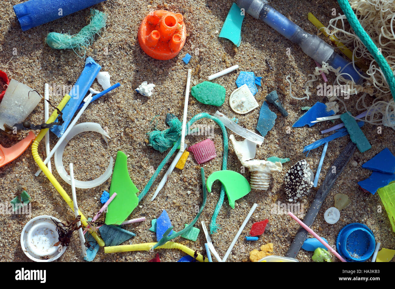 Plastic debris washed ashore on the beach. Plastic pollution. Portugal - Stock Image