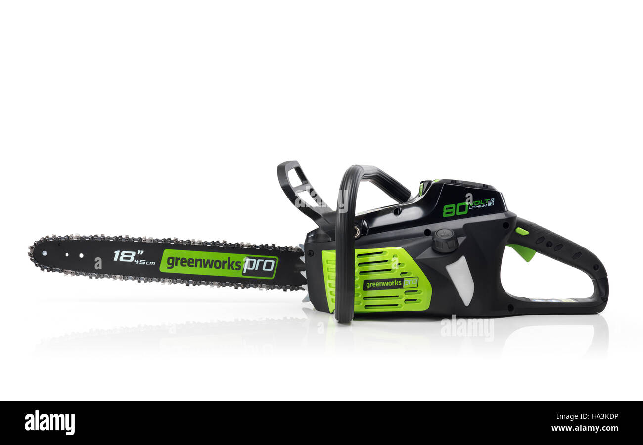 Electric Cordless battery powered chainsaw Greenworks isolated on white background - Stock Image
