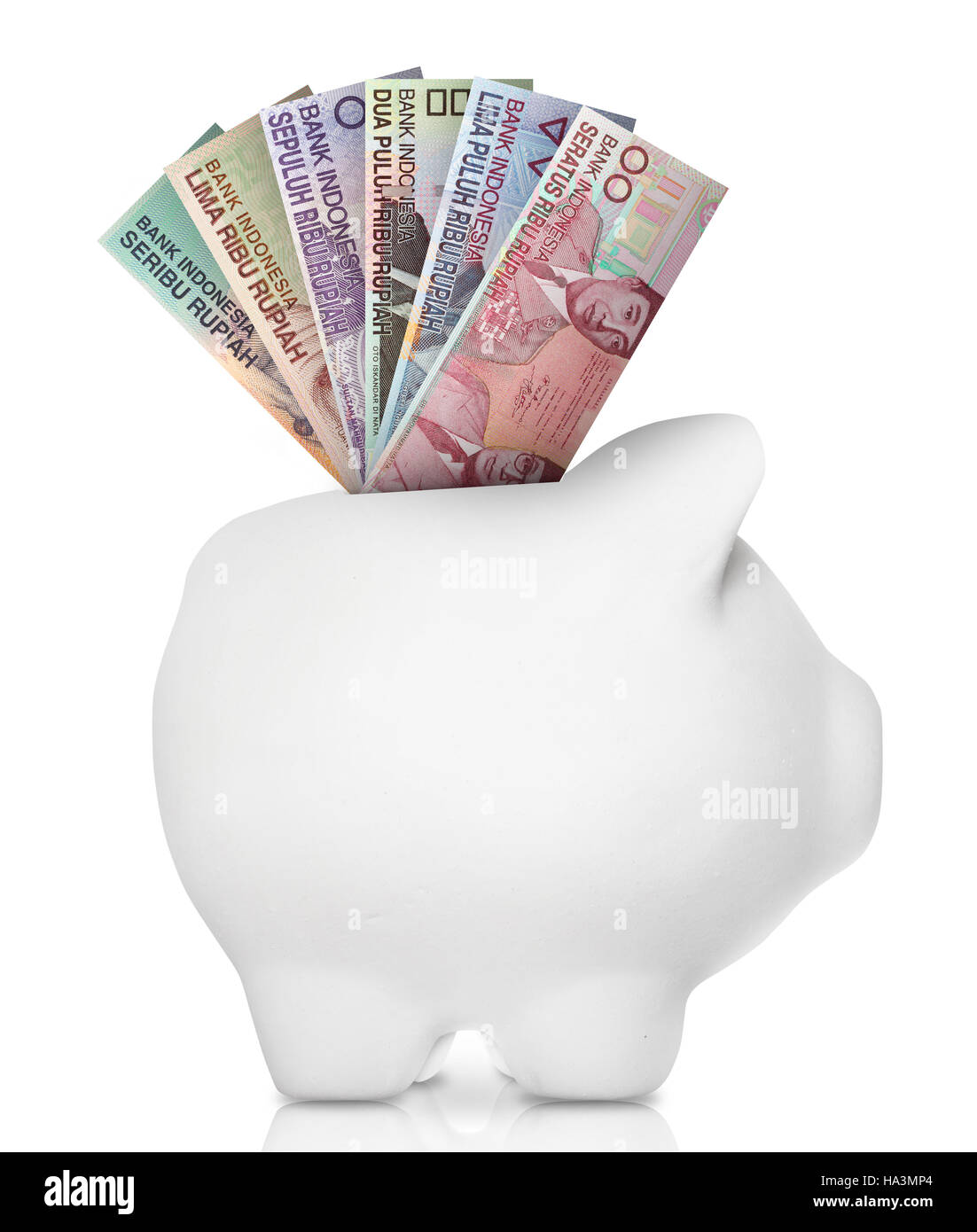 A white piggy bank filled with multiple bank notes. - Stock Image