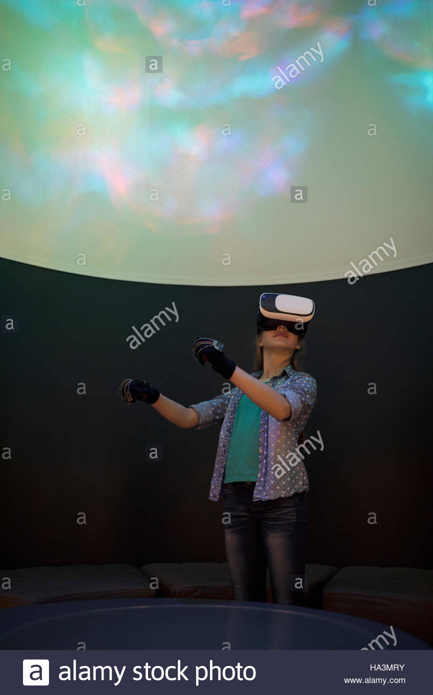 Girl using virtual reality simulator in science center theater - Stock Image