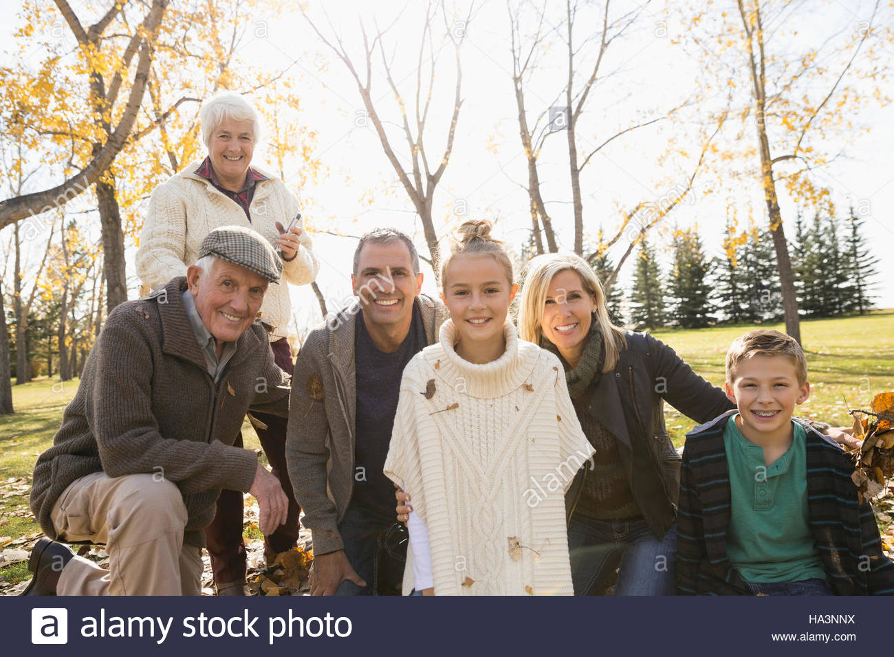 Portrait smiling multi-generation family in sunny autumn park - Stock Image