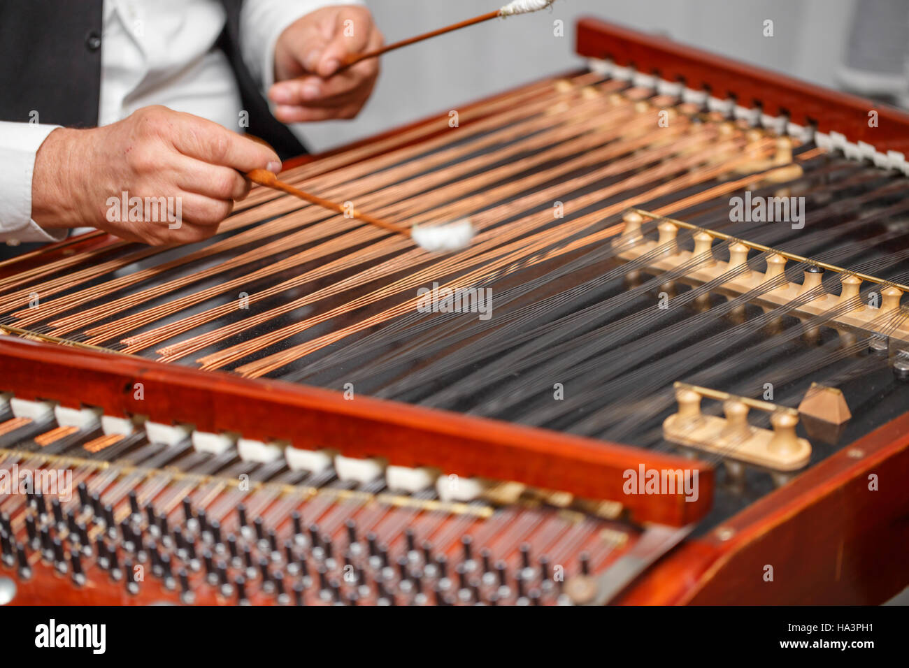 Playing the dulcimer folk musical instrument Stock Photo