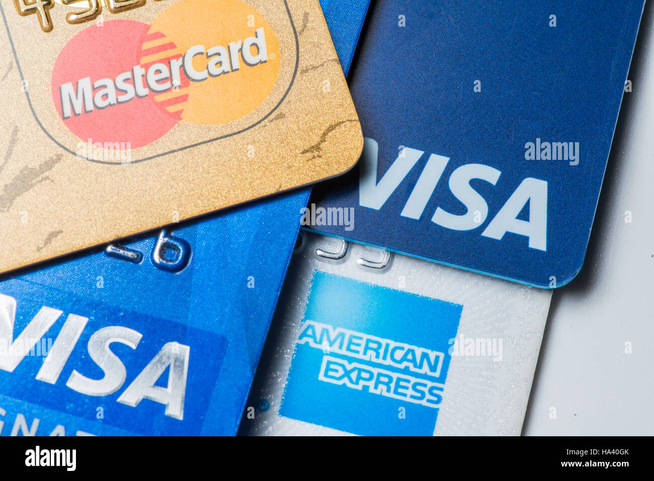 Close up of credit cards with MasterCard,Visa and American Express logos on white background,illustrative editorial - Stock Image