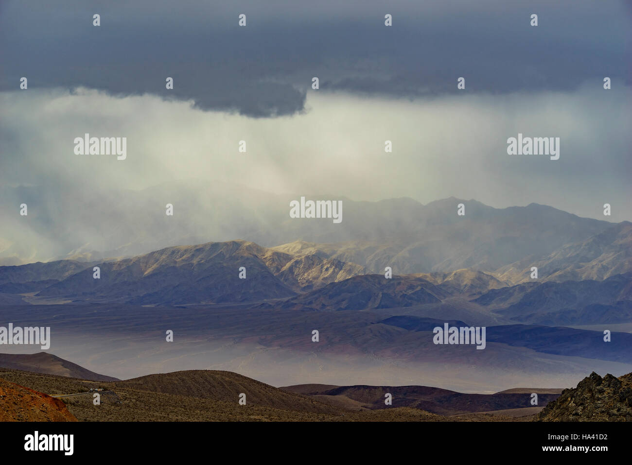 Beautiful sun ray while raining over mountain at Death Valley National Park - Stock Image