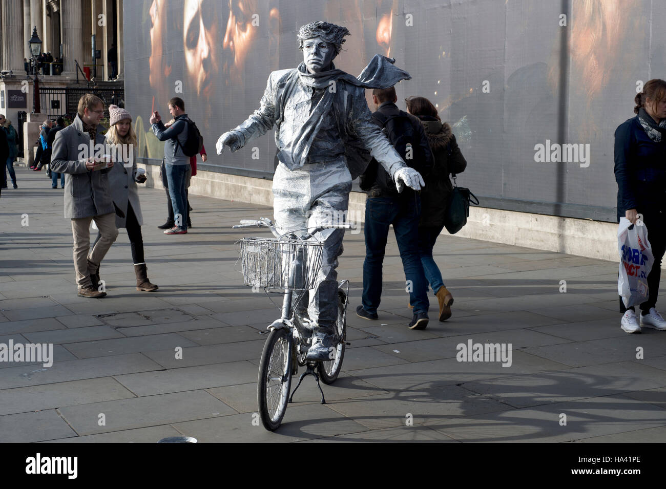 National Gallery, Trafalgar Square. Mime artist on a bicycle and passers-by Stock Photo