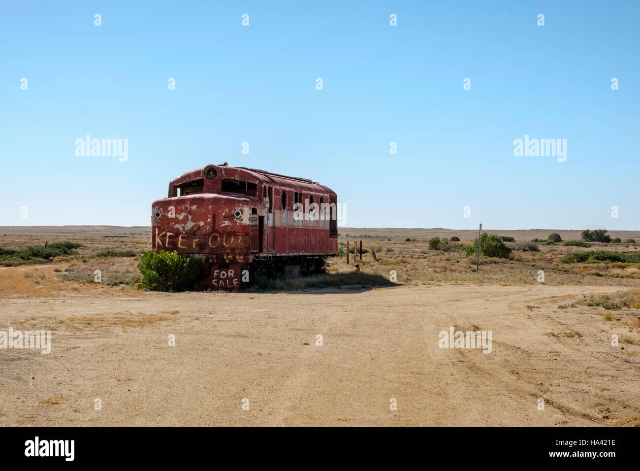 An old diesel locomotive stands abandoned at Marree in the Australian Outback - Stock Image