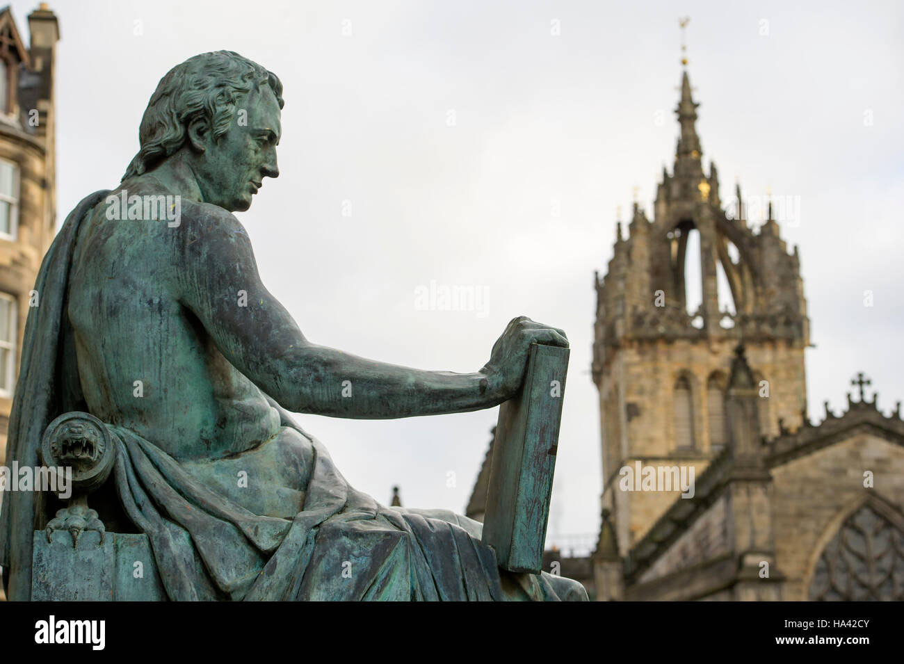 The statue of philosopher David Hume (1711 -1776) sits outside the High Court at the Lawnmarket on Edinburgh's - Stock Image