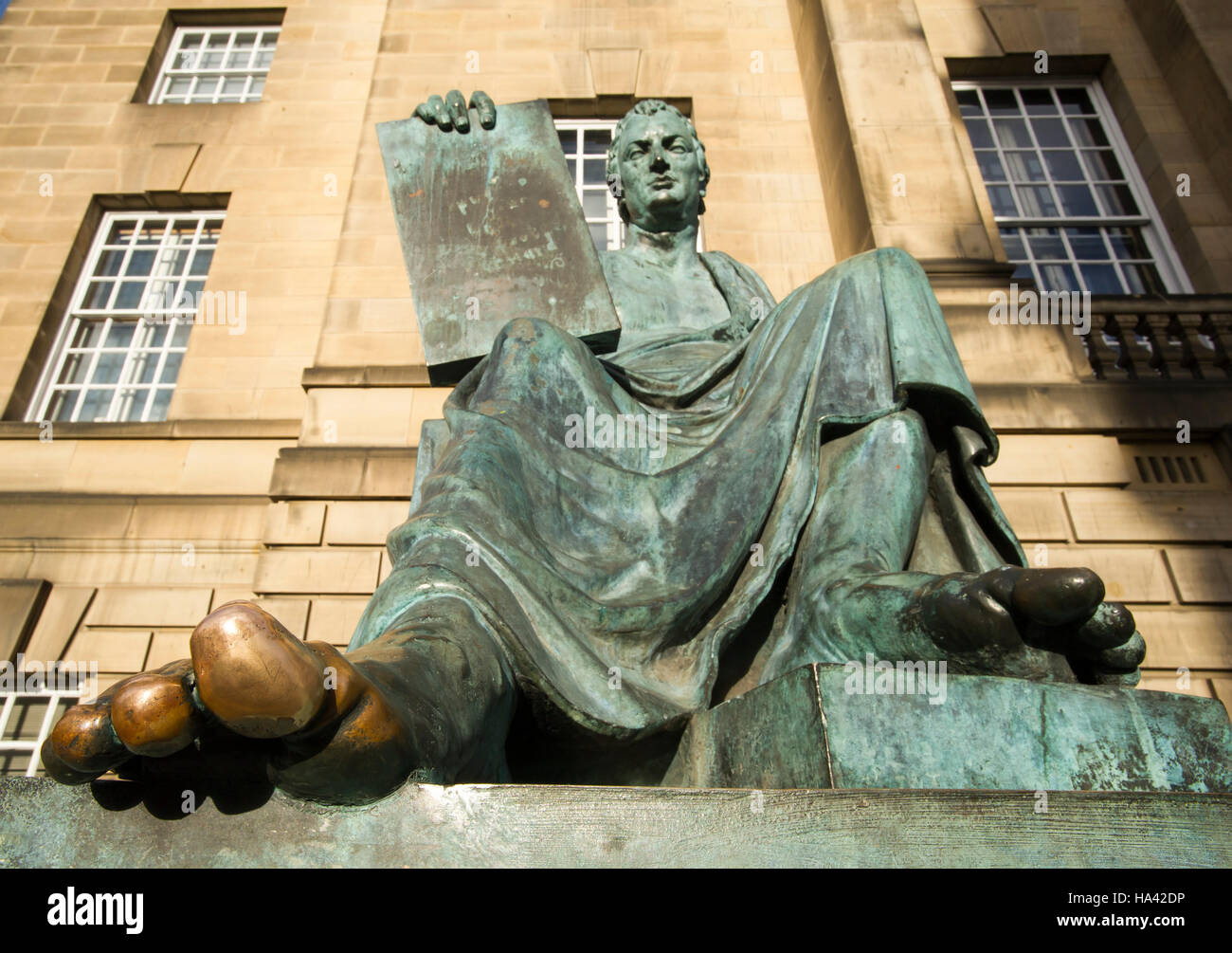The statue of philosopher David Hume (1711 -1776) sits outside the High Court at the on Edinburgh's Royal Mile. - Stock Image