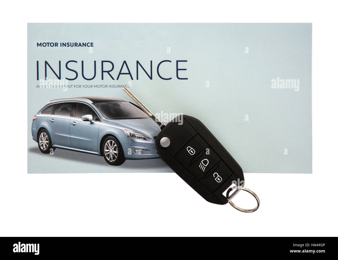 Certificate of motor insurance and policy schedule with car key - Stock Image