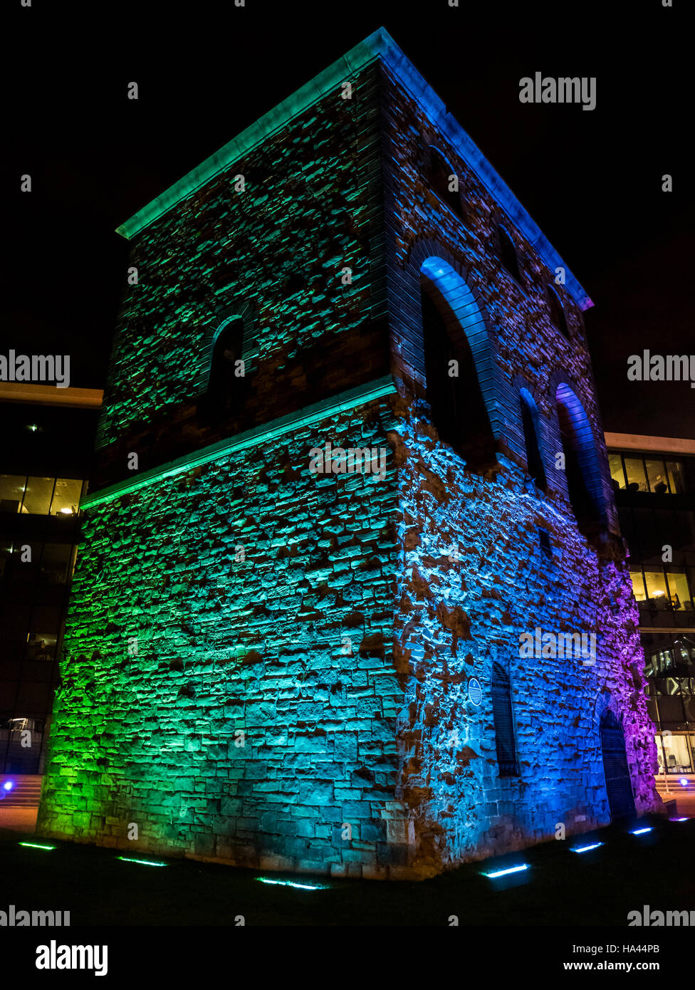 The stunningly lit old Wagon Lifting Tower, Wellington Place, Leeds, on a dark autumn evening - Stock Image