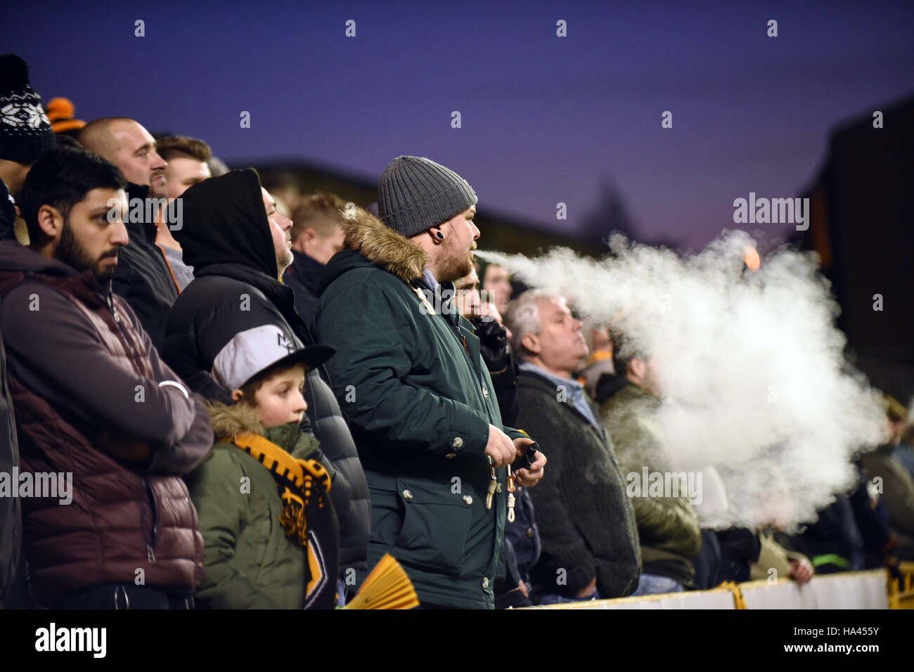 Man vaping in crowd at football match - Stock Image