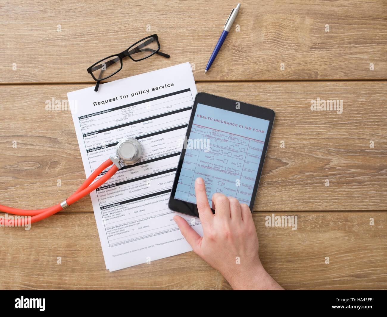 Health insurance claim internet online form - Stock Image