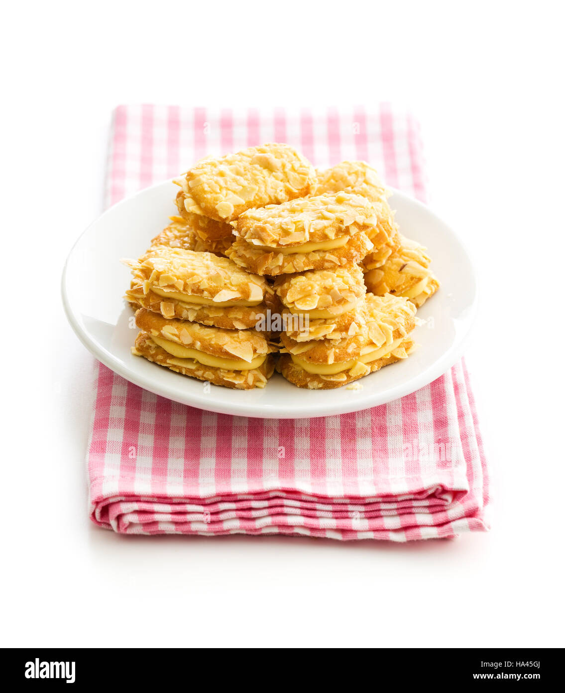 Sweet almond cookies on plate isolated on white background. - Stock Image