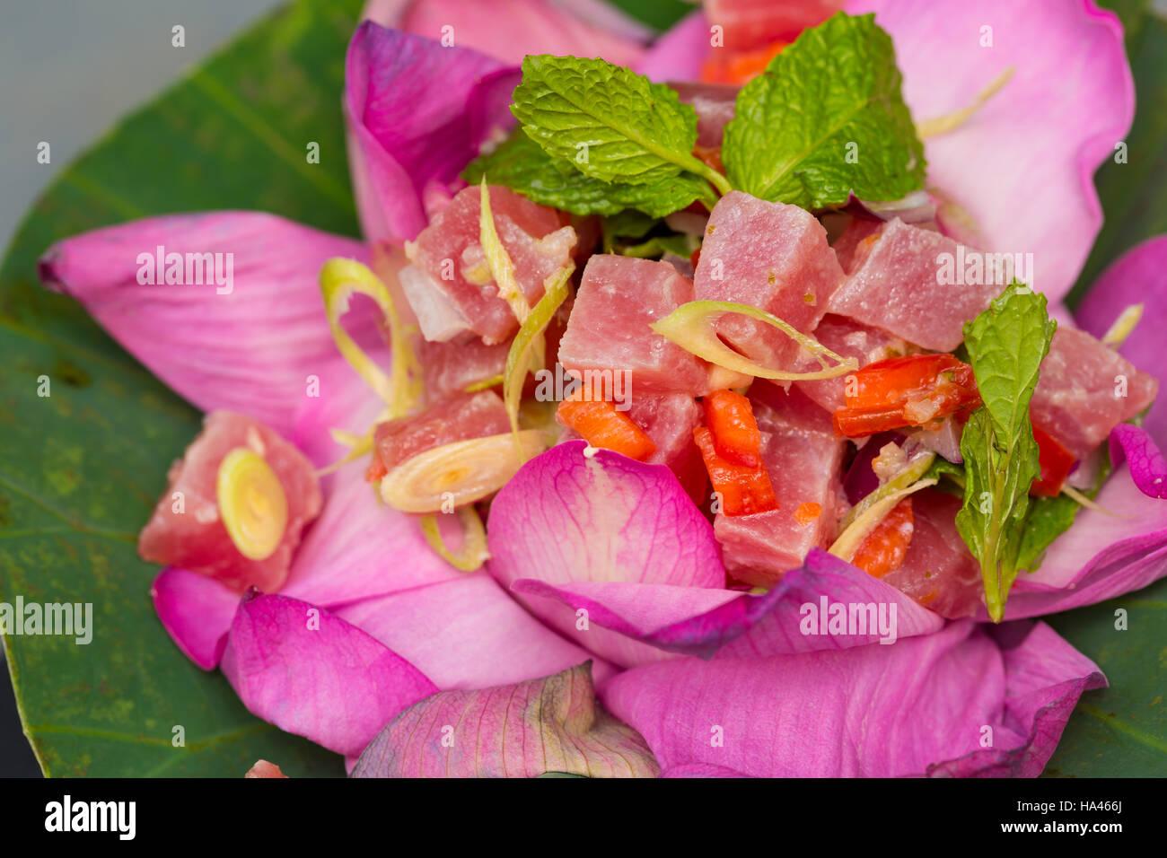 Thai ahi tuna salad served in a beautiful lotus flower stock photo thai ahi tuna salad served in a beautiful lotus flower izmirmasajfo