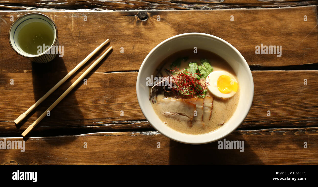 Bowl of Japanese Ramen with Chopsticks and Teacup - Stock Image