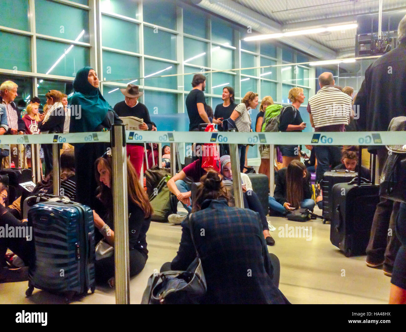 San Francisco, CA, USA, Inside, Airline Passengers Queuing up in Terminal, Late Plane at Night - Stock Image