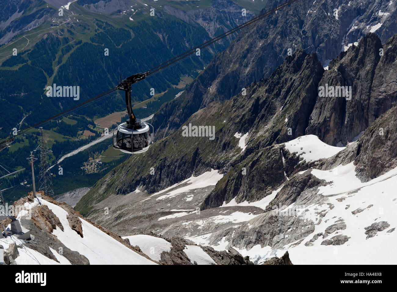 Valle d'Aosta Monte Bianco cableway snow rocks panorama - Stock Image