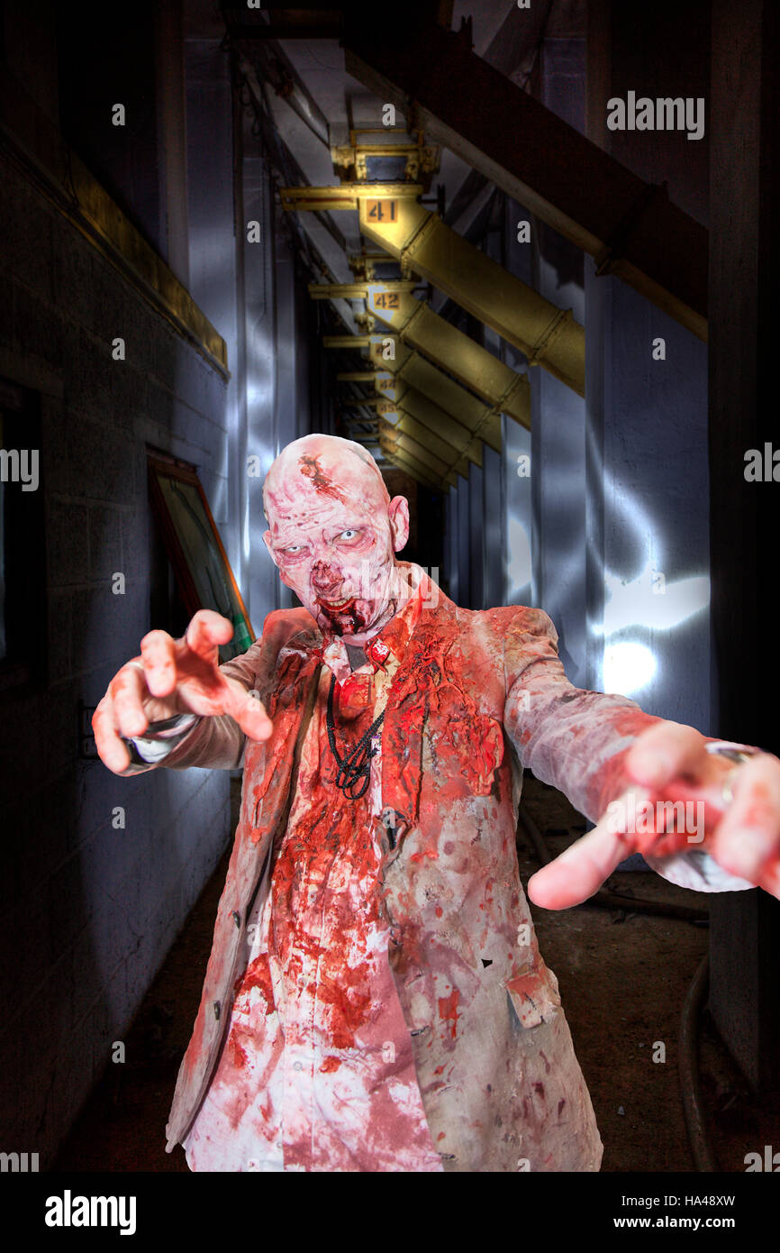 Walking dead zombie undead, man covered in blood, eating brains scary man, horror film, zombies voodoo, blood stained Stock Photo