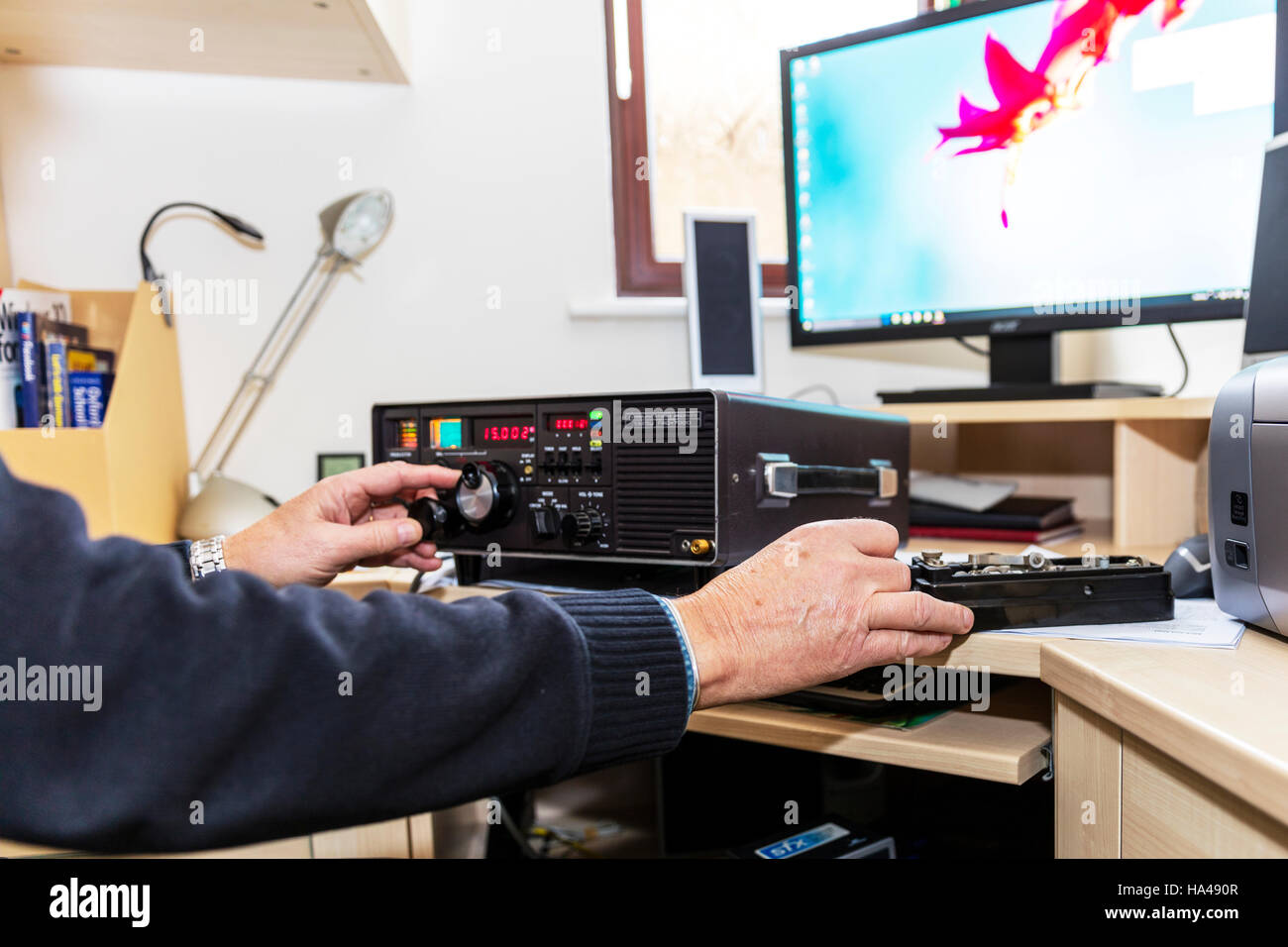 amateur radio enthusiast Radio ham man using Yaesu FRG 7000 High Frequency receiver UK England GB changing frequency - Stock Image