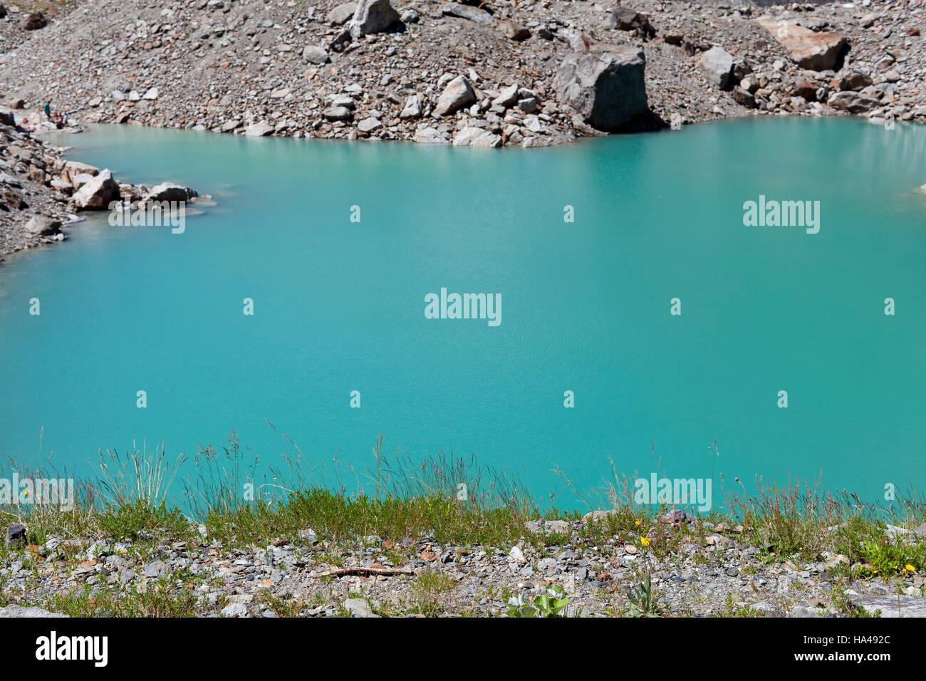 Val Veny Miage lake Italy green water rocks beautiful nature - Stock Image