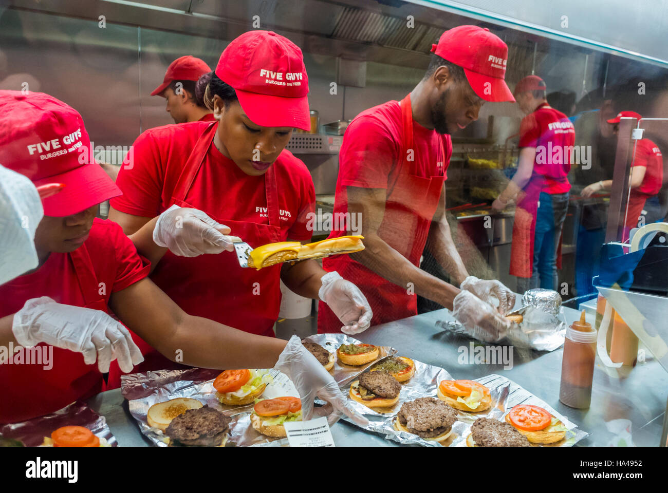 Paris, France, Group of Diverse French People, Teenagers, Working in Kitchen inside American Fast Food Restaurant, - Stock Image
