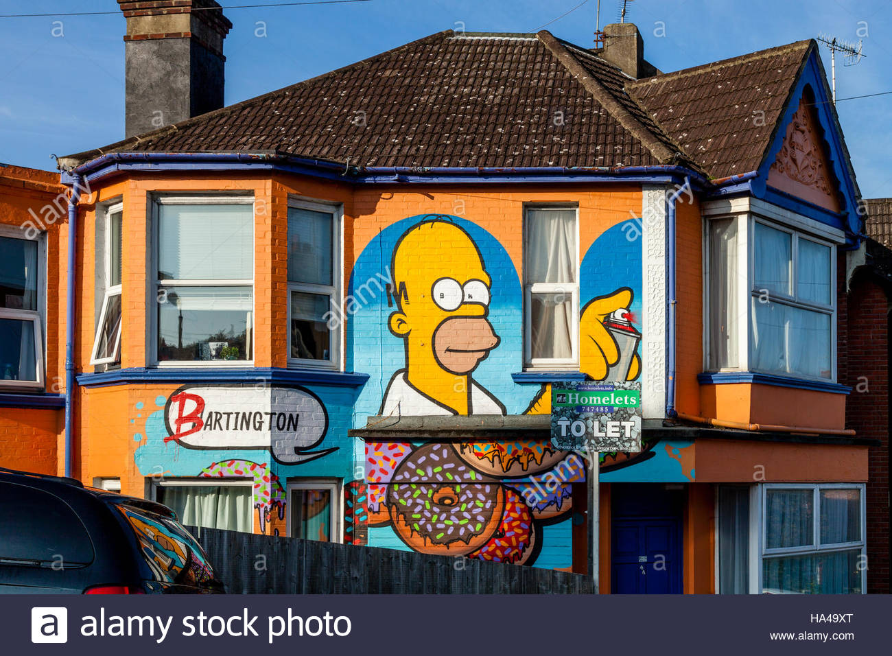 A Colourful House Exterior Painted With An Image Of The Cartoon Character Homer Simpson, Brighton, Sussex, UK - Stock Image