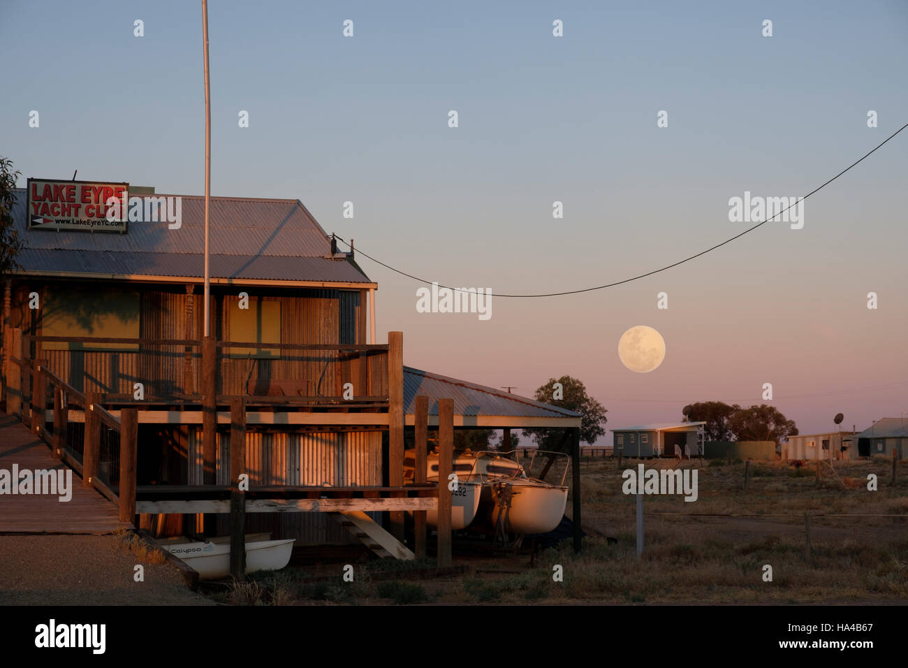 A super moon rises near the Lake Eyre Yacht Club at Marree in Outback Australia - Stock Image
