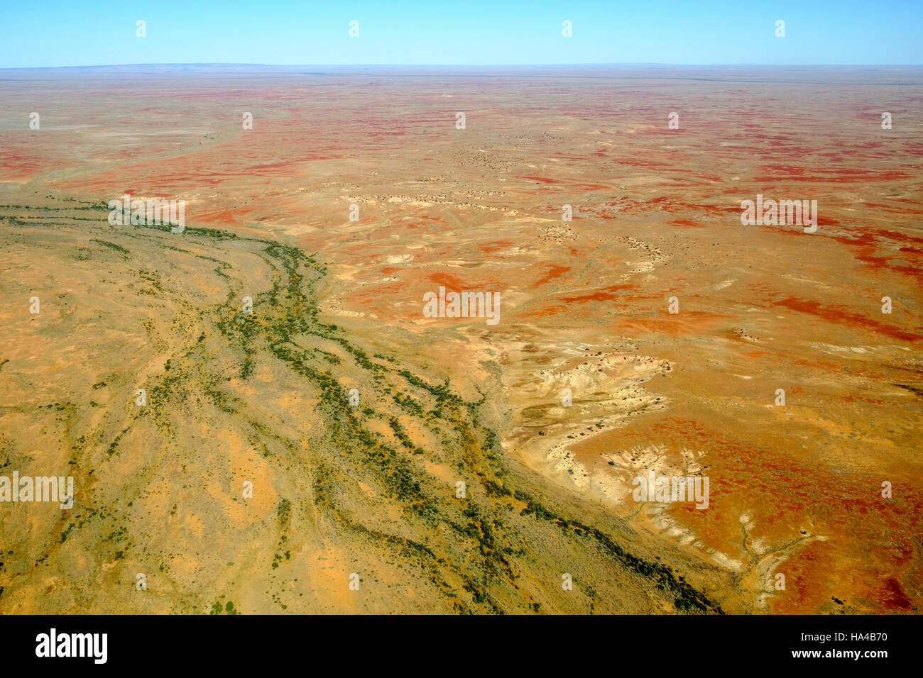 An aerial view of creeks cutting through the parched Australian Outback desert in South Australia's far north. - Stock Image