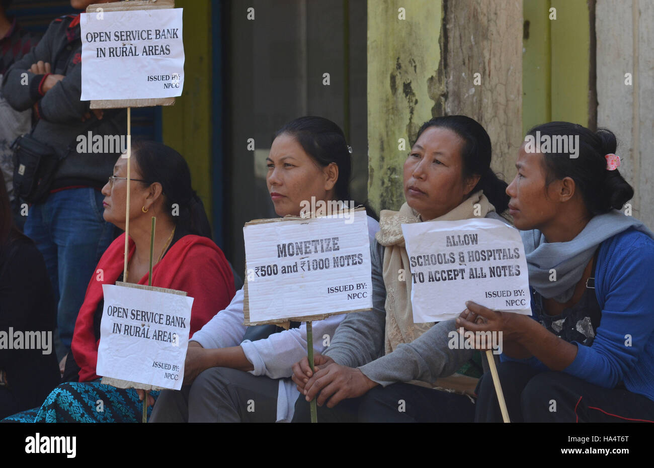 Dimapur, India. 28th Nov, 2016. Supporters of Indian National Congress party holds placard at protest rally against - Stock Image