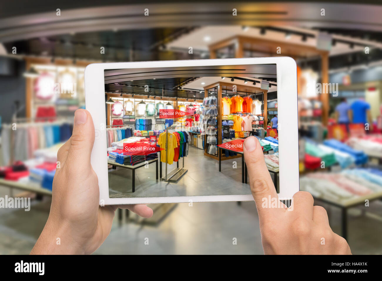 Augmented reality marketing concept. Hand holding digital tablet smart phone use AR application to check special - Stock Image