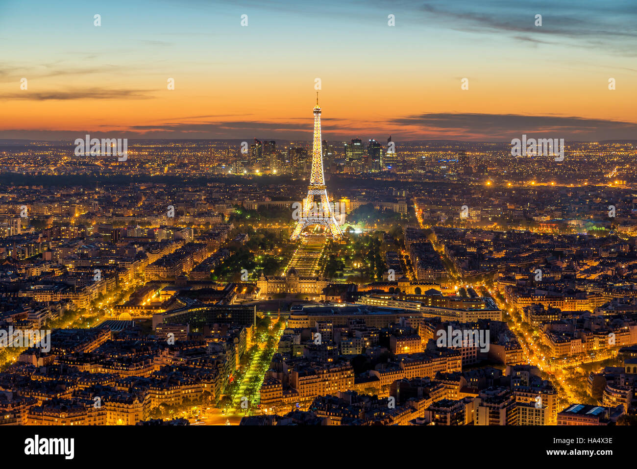 Beautiful view Eiffel tower during light show at dusk, Paris, France. Stock Photo