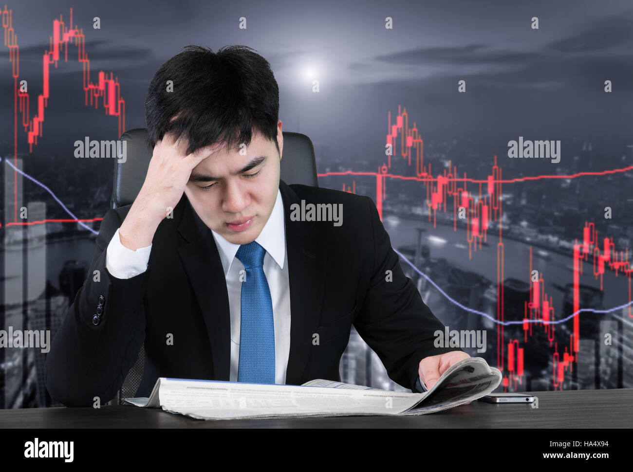 Businessman reading bed news from newspaper for loss value and feel pain strain with trading candlestick chart background. - Stock Image