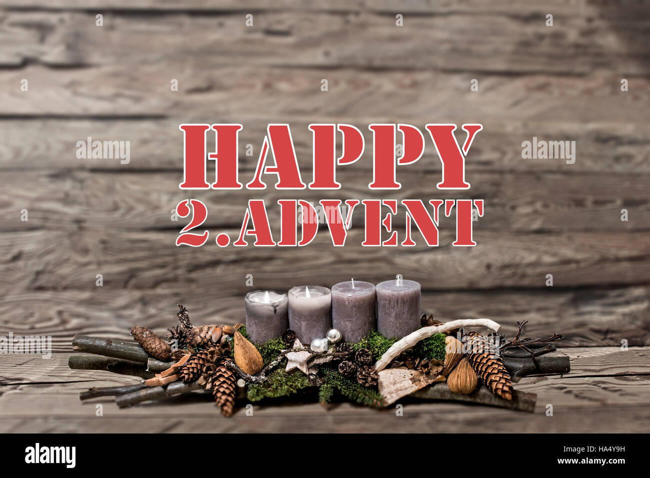 Merry Christmas decoration advent with burning grey candle Blurred background text message englisch 2nd - Stock Image