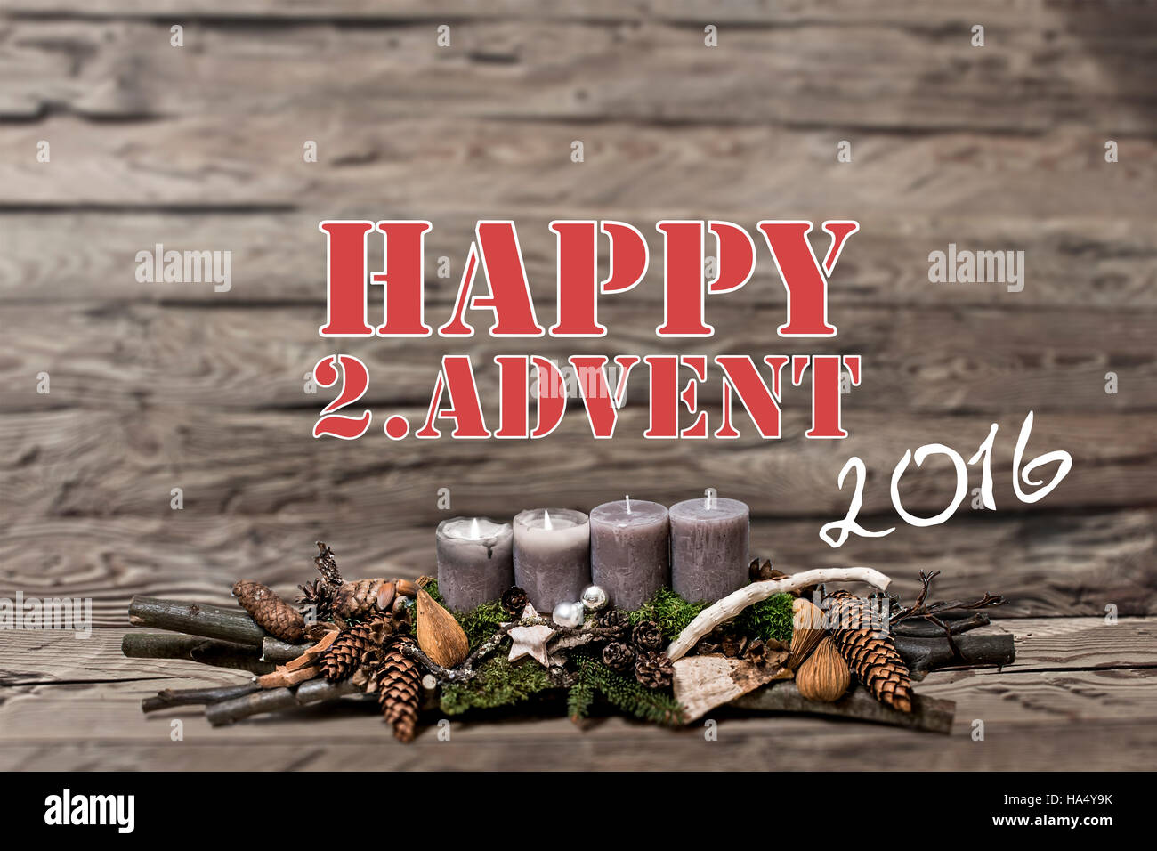 Merry Christmas decoration advent 2016 with burning grey candle Blurred background text message englisch 2nd - Stock Image