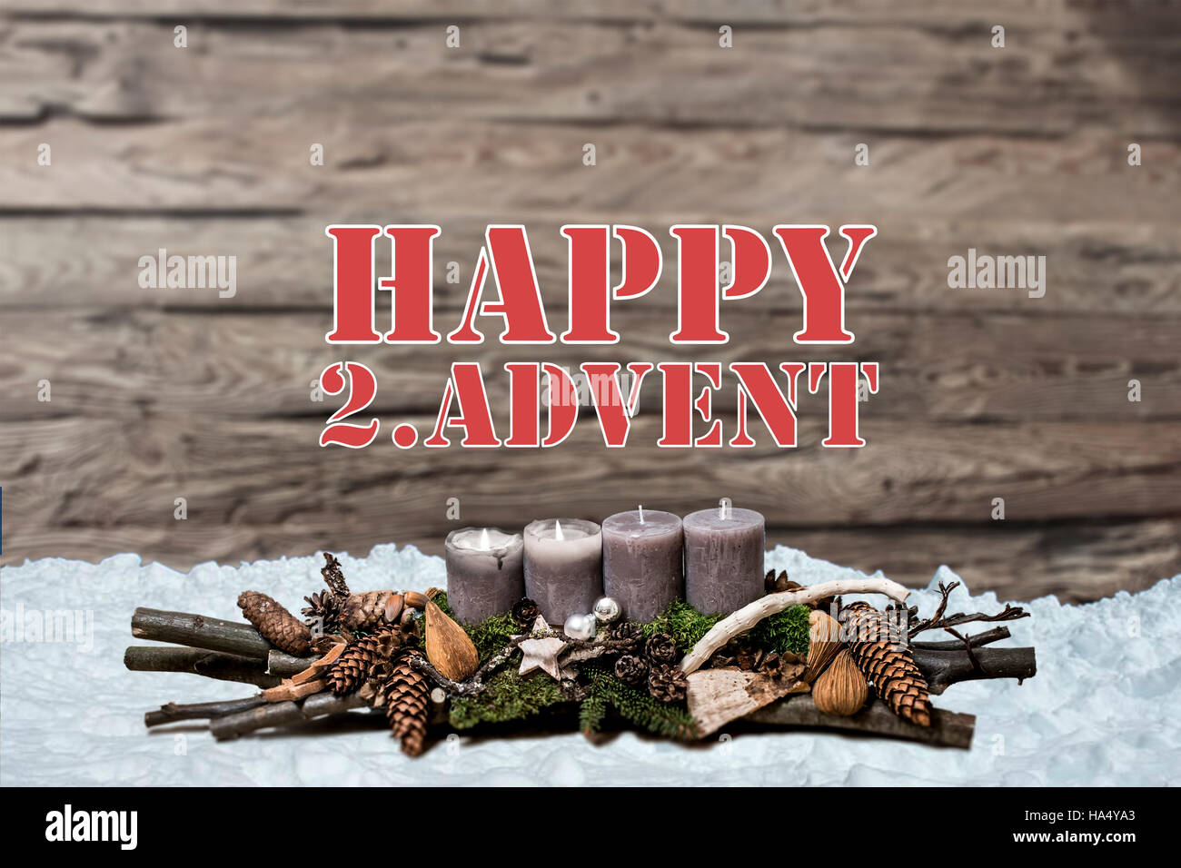 Merry Christmas decoration advent with burning grey candle Blurred background snow text message englisch 2nd - Stock Image
