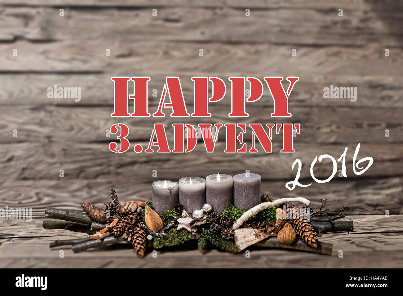 Merry Christmas decoration advent 2016 with burning grey candle Blurred background text message englisch 3rd - Stock Image