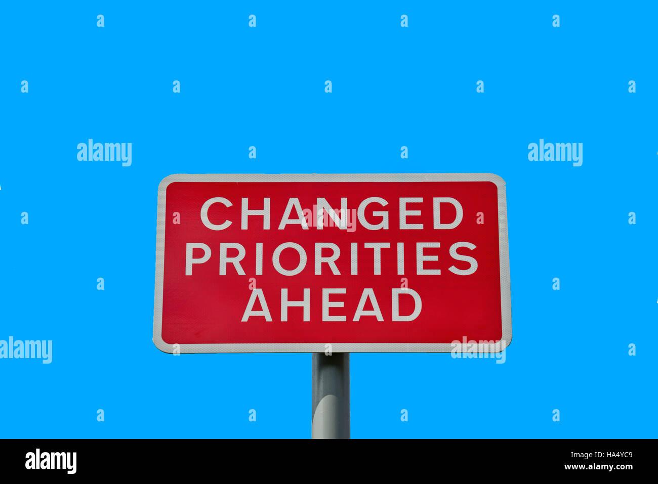 'Changed priorities ahead' sign, Princes Street, Swindon, Wiltshire, England, United Kingdom - Stock Image