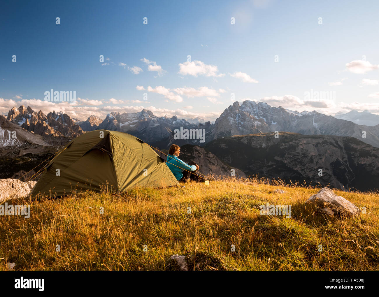 sportsman in high mountains camping - Stock Image