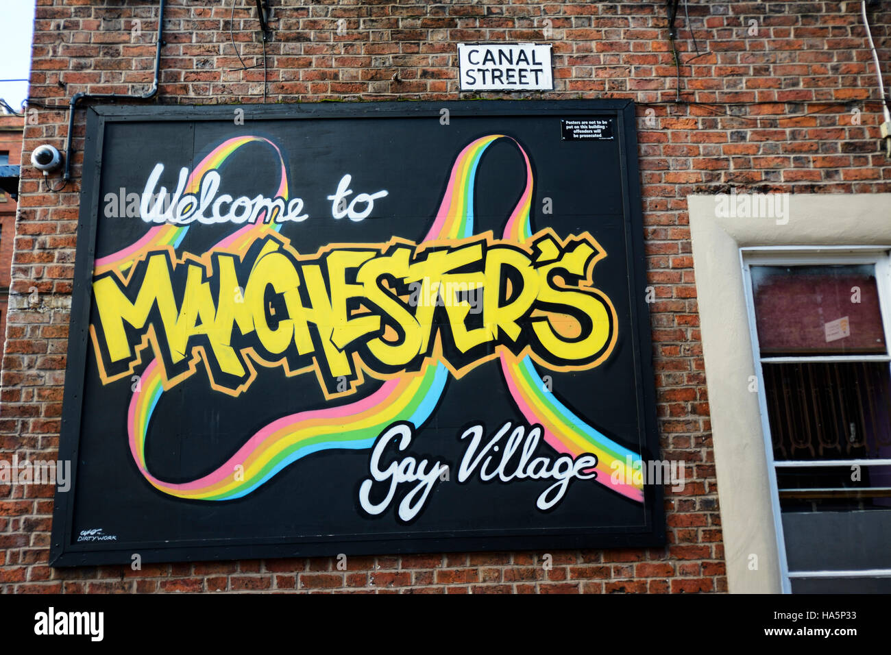 Welcome to Manchester's gay village sign in Canal Street, Manchester. - Stock Image