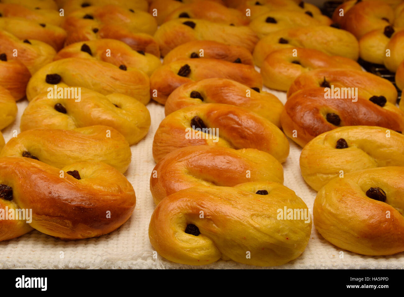 Home made Lucia bakery with raisin. - Stock Image