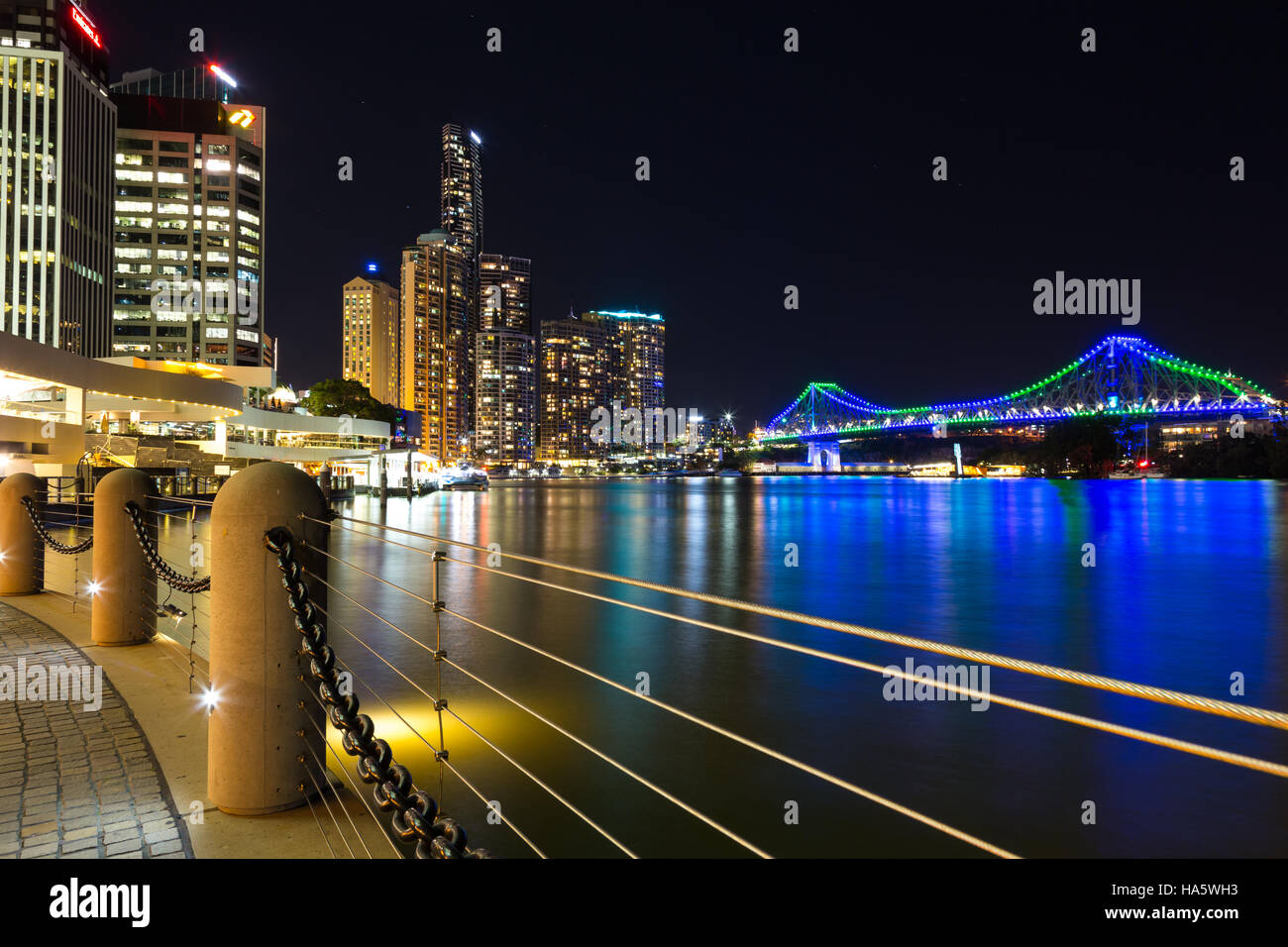 Brisbane night skyline with river and Story Bridge - Stock Image