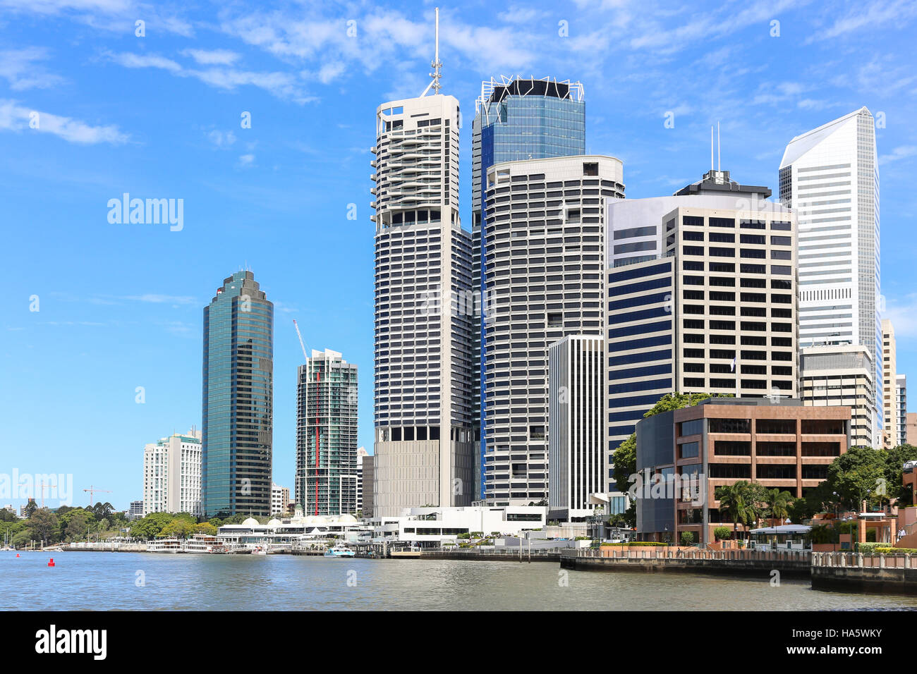 Brisbane city CBD skyline with skyscrapers next to the river promenade - Stock Image