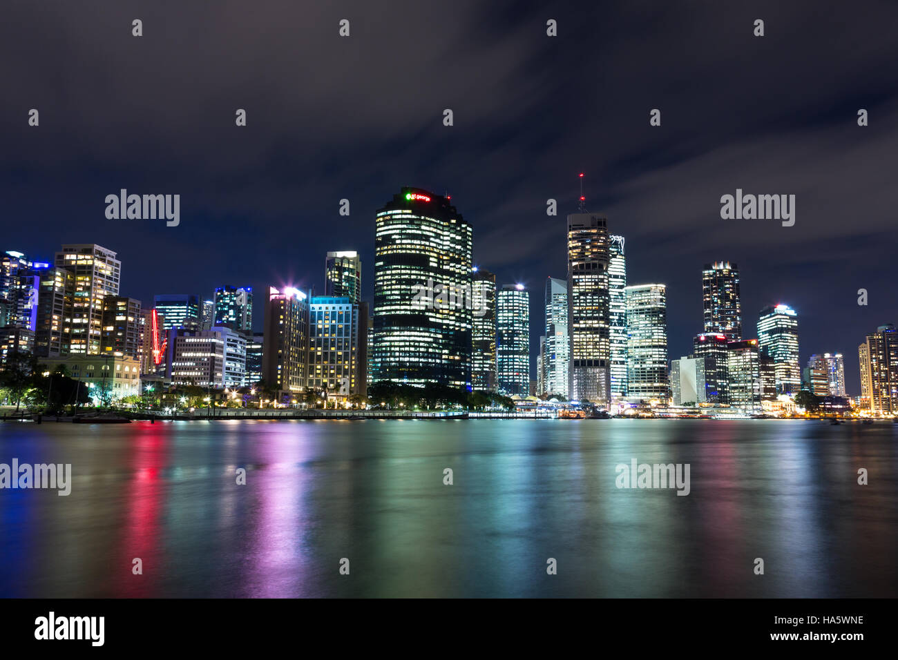 Brisbane city nighttime skyline with colorful reflections in the river - Stock Image