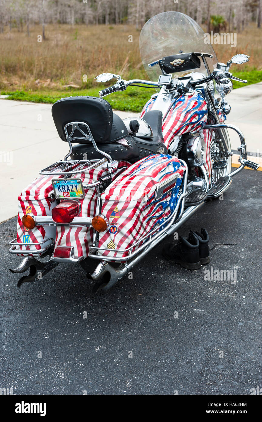 A custom motorcycle painted with the colors of the American flag - Stock Image