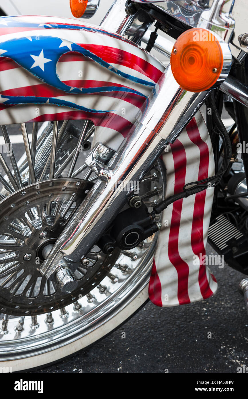 Detail of a custom motorcycle front wheel and fender painted with the colors of the American flag, United States - Stock Image