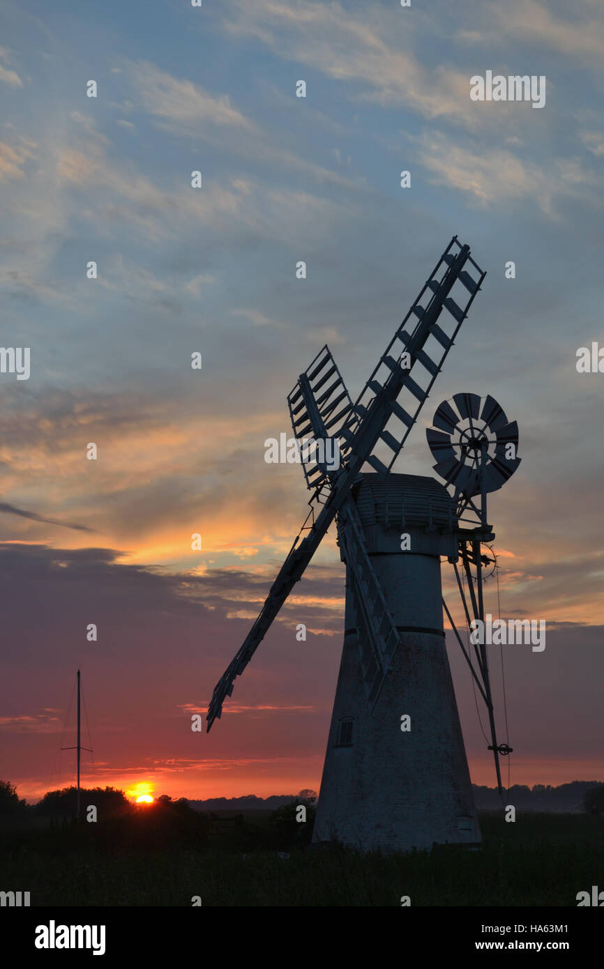 The white painted Thurne Mill on the River Thurne, Norfolk Broads at sunset. Stock Photo