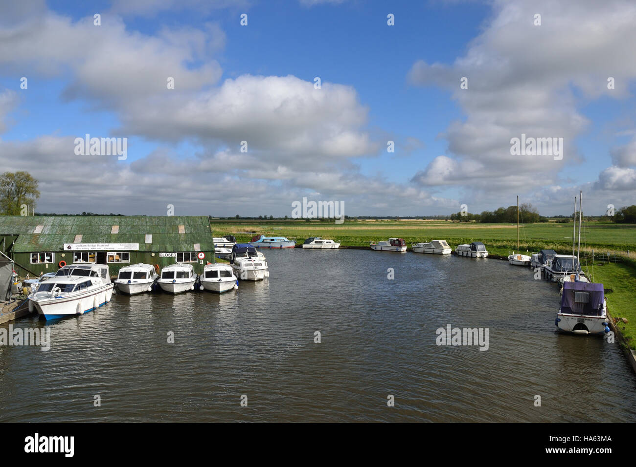Boats moored at Ludham Bridge Boatyard on the River Ant on the Norfolk Broads. Stock Photo